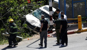 The scene of a car attack that left one Israeli dead in the settlement of Ofra in the West Bank, April 6, 2017.