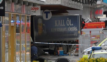 The truck involved in a deadly ramming attack protrudes from a department store in Stockholm, Sweden, April 7, 2017.