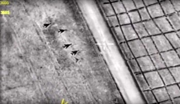 A snapshot in a video from the Russian Defense Ministry's press service shows aircraft at the Shayrat airbase  after it was hit by US strike on April 8, 2017.
