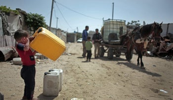 A water distribution point in Khan Yunis in the Gaza Strip, 2016.