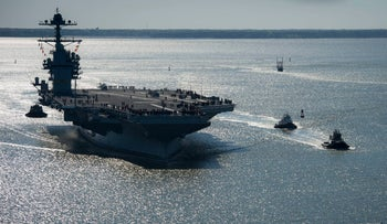 The USS Gerald R. Ford embarks on the first of its sea trials to test various state-of-the-art systems, April 8, 2017.