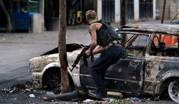 A Palestinian gunman during clashes between Fatah and Islamic groups in the Ein el-Hilweh refugee camp in Lebanon.