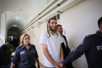 Raphael Morris, chairman of of the Return to the Temple Mount movement, under arrest before Passover in 2016.