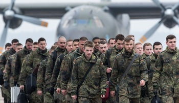 German Bundeswehr soldiers arrive at an airport in Kaunas, Lithuania, February 1, 2017.