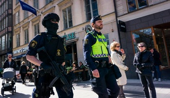 Police officers patrol on April 9, 2017 near the point where a truck drove into a department store in Stockholm, Sweden.