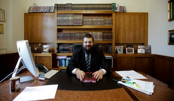 On Monday April 3, 2017 Rabbi Yehuda Teichtal sits at his desk during an interview.