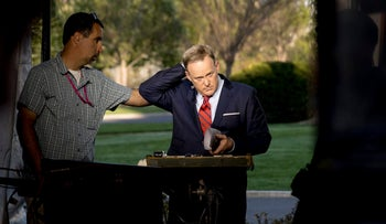 White House press secretary Sean Spicer finishes a cable news interview on the North Lawn of the White House, Tuesday, April 11, 2017, in Washington.