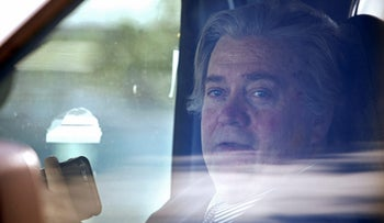 White House Chief Strategist Steve Bannon looks out from inside a vehicle as U.S. President Donald Trump motorcade prepares to depart Mar-a-Lago estate in Palm Beach, Florida, U.S., April 9, 2017.