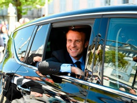 French presidential election candidate for the En Marche ! movement Emmanuel Macron smiles in a car during a campaign visit in Bagneres de Bigorre on April 12, 2017.