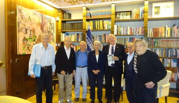President Reuven Rivlin, with photo, and Palmach veterans, February 2017.