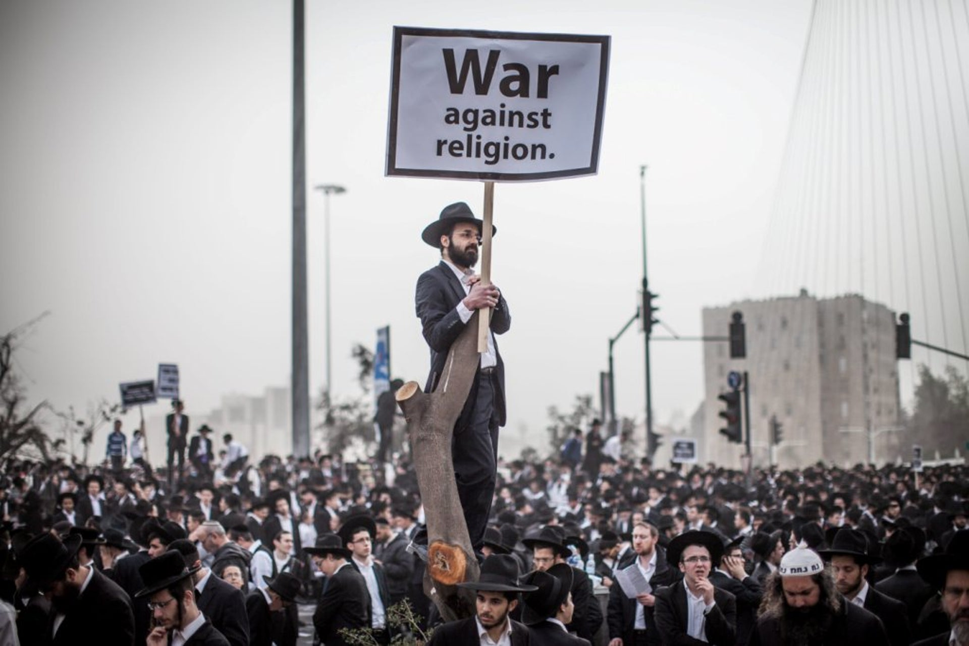 2014 | Jerusalem, Ultra-Orthodox Jews protest against legislation that would end religious exemptions for their community from Israel's universal conscription requirements.