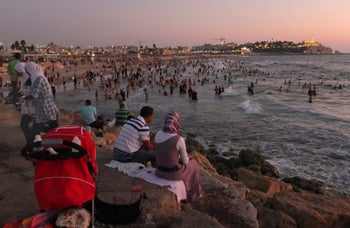 2012 | Beach in Tel Aviv. Palestinians from the West Bank bathe in the sea, many for the first time. Israel granted them special permits for Id al-Fitr, which marks the end of the month of Ramadan.