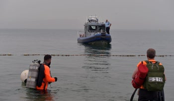 Rescuers search for the three missing people on the shore of the Sea of Galilee in northern Israel, April 12, 2017.