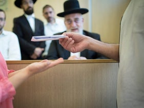 A couple gets a divorce at a rabbinical court.