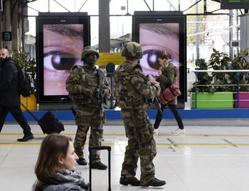 Military soldiers patrol the Austerlitz train station in Paris on November 14, 2015.