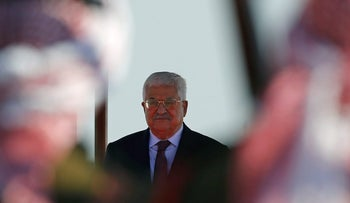 FILE PHOTO: Palestinian President Mahmoud Abbas stands on podium during a reception ceremony at the Queen Alia International Airport in Amman, Jordan March 28, 2017.