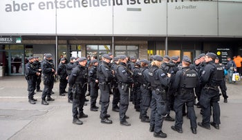Police is seen outside the stadium prior to the UEFA Champions League 1st leg quarter-final football match BVB Borussia Dortmund v Monaco in Dortmund, western Germany on April 12, 2017.