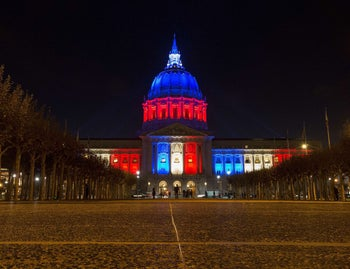 San Francisco's City Hall is illuminated in blue, white and red in San Francisco, California on November 14, 2015.