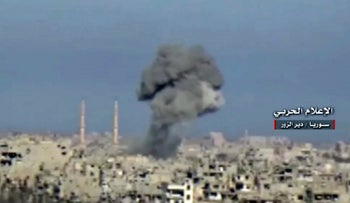 FILE PHOTO: Frame grab from video provided by the government-controlled Syrian Central Military Media, black smoke rises from an airstrike on an Islamic State group's position, in Deir al-Zour, north Syria. Jan. 30, 2017.