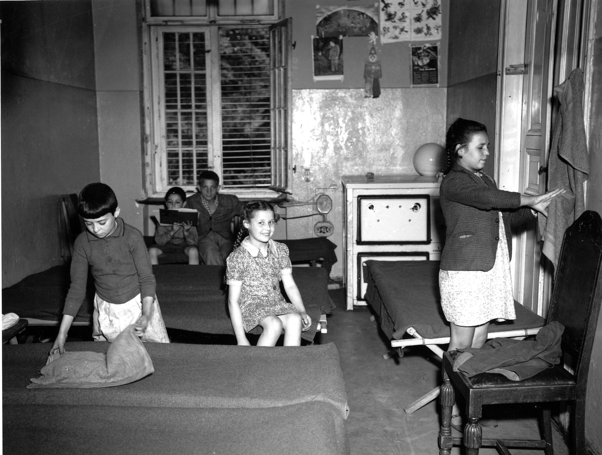 This group of Jewish orphans are seen in their room in the Duppel Center on Aug. 19, 1946, a displaced persons camp in suburban Berlin, Germany.