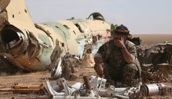 A Syrian Democratic Forces fighter rests at Tabqa military airport after taking control of it from ISIS fighters, Syria April 9, 2017.