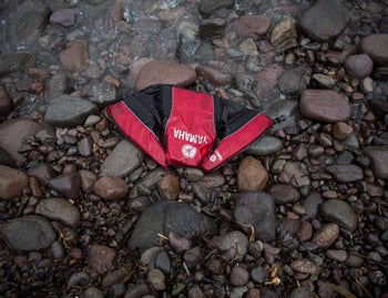 A lifejacket remains left behind on a beach next to the town of Skala Sikaminias, on the northeastern Greek island of Lesbos, Oct. 8, 2015.