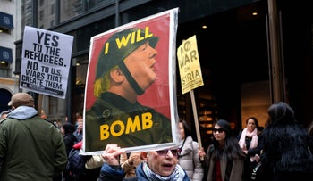 Anti-war demonstrators shout slogans against President Donald Trump during a demonstration in front of the Trump Tower in New York on April 7, 2017, to protest the U.S. airstrike in Syria.