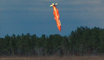 GBU-43/B Massive Ordnance Air Blast bomb prototype moments before impact in an undisclosed location.