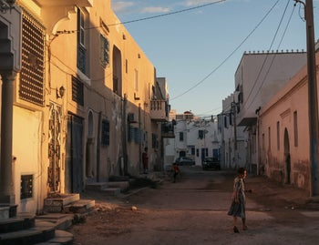 A girl walks home after sunset, at Hara Kbira, the main Jewish neighborhood on the Island of Djerba, southern Tunisia, Oct. 30, 2015.
