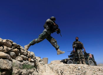 A member of Afghanistan's special forces unit patrols in Pandola village in the Achin district of Nangarhar, Afghanistan, April 14, 2017.