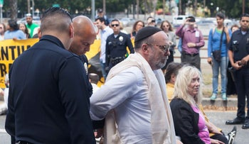 Rabbi Aryeh Cohen being arrested at the interfaith protest in Los Angeles, April 13, 2017.