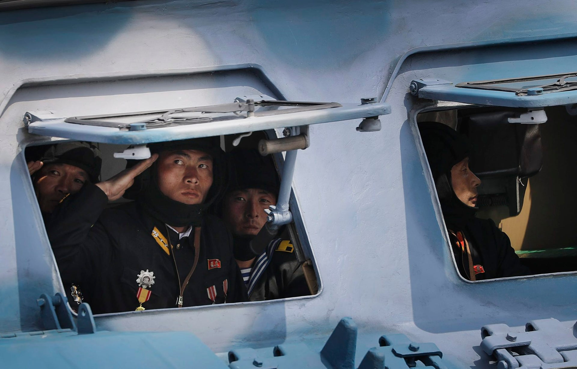 North Korean soldiers look out of a military vehicle during a military parade in honor of the country's founder Kim Il-Sung, in Pyongyang, April 15, 2017.
