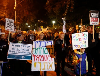 Thousands march in Tel Aviv in protest of incitement against Rivlin, leftist NGOs. December 19, 2015.