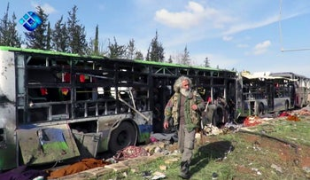 This frame grab from video provided by the Thiqa News Agency shows the buses that were damaged in a blast in a rebel-controlled district outside Aleppo city, Syria, Saturday, April 15, 2017.
