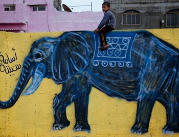 Elephant painting done by a group of artists that painted walls, doorsteps and facades of all the houses along 1.5 kilometer-long edge, including in the area where Haniya lives, December 15, 2015.