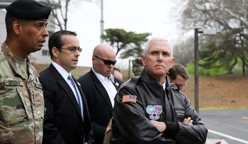 U.S. Vice President Mike Pence, right, visits to the truce village of Panmunjom in the Demilitarized Zone (DMZ) in Paju, South Korea, on Monday, April 17, 2017.