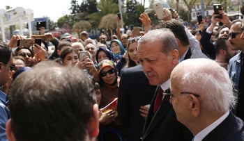 Turkish President Recep Tayyip Erdogan talks to supporters as he arrives at Eyup Sultan mosque in Istanbul, Turkey, April 17, 2017.