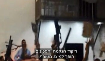 This still from the video of a wedding among right-wing activists shows dancers brandishing rifles, a twist on traditional wedding dances.