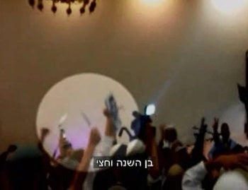 Stabbing the picture of Ali Dawabsheh (the 1.5-year old baby  burned do death with his parents in the village of Duma) while dancing with knives at a wedding among right-wing activists in Jerusalem.