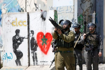 Israeli security forces fire tear gas at Palestinian protesters following a demonstration in support of prisoners on a hunger strike, Bethlehem, West Bank, April 17, 2017.