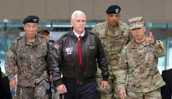 U.S. Vice President Mike Pence arrives with military officials at a border village in the DMZ separating North and South Korea, April 17, 2017.