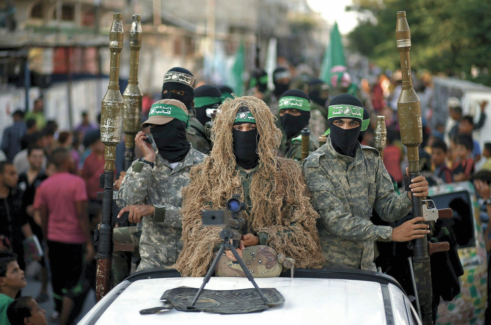 Hamas militants take part in a military parade in Gaza.
