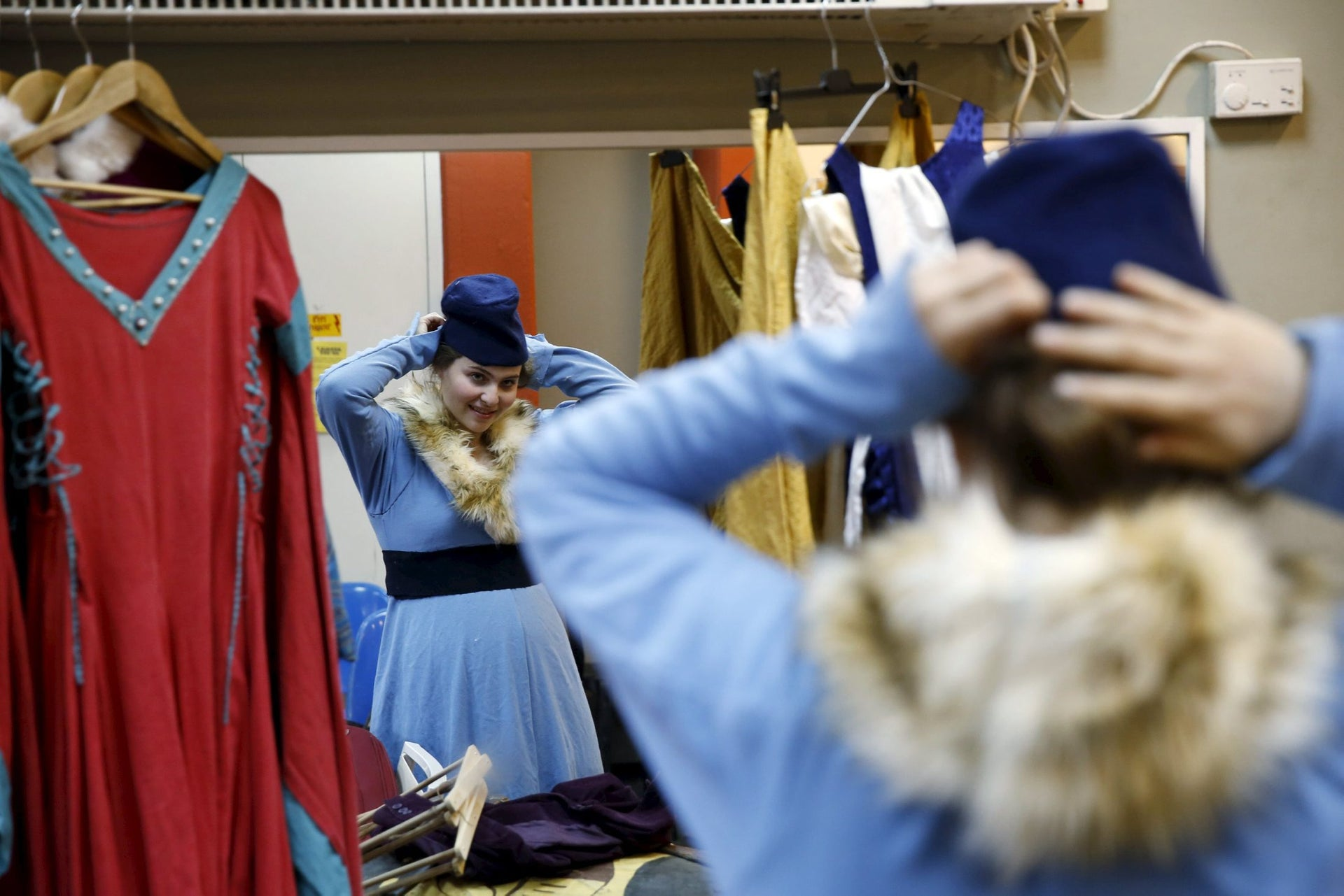 A woman checks out her costume in the mirror before an international medieval tournament in Tel Aviv, January 23, 2016.