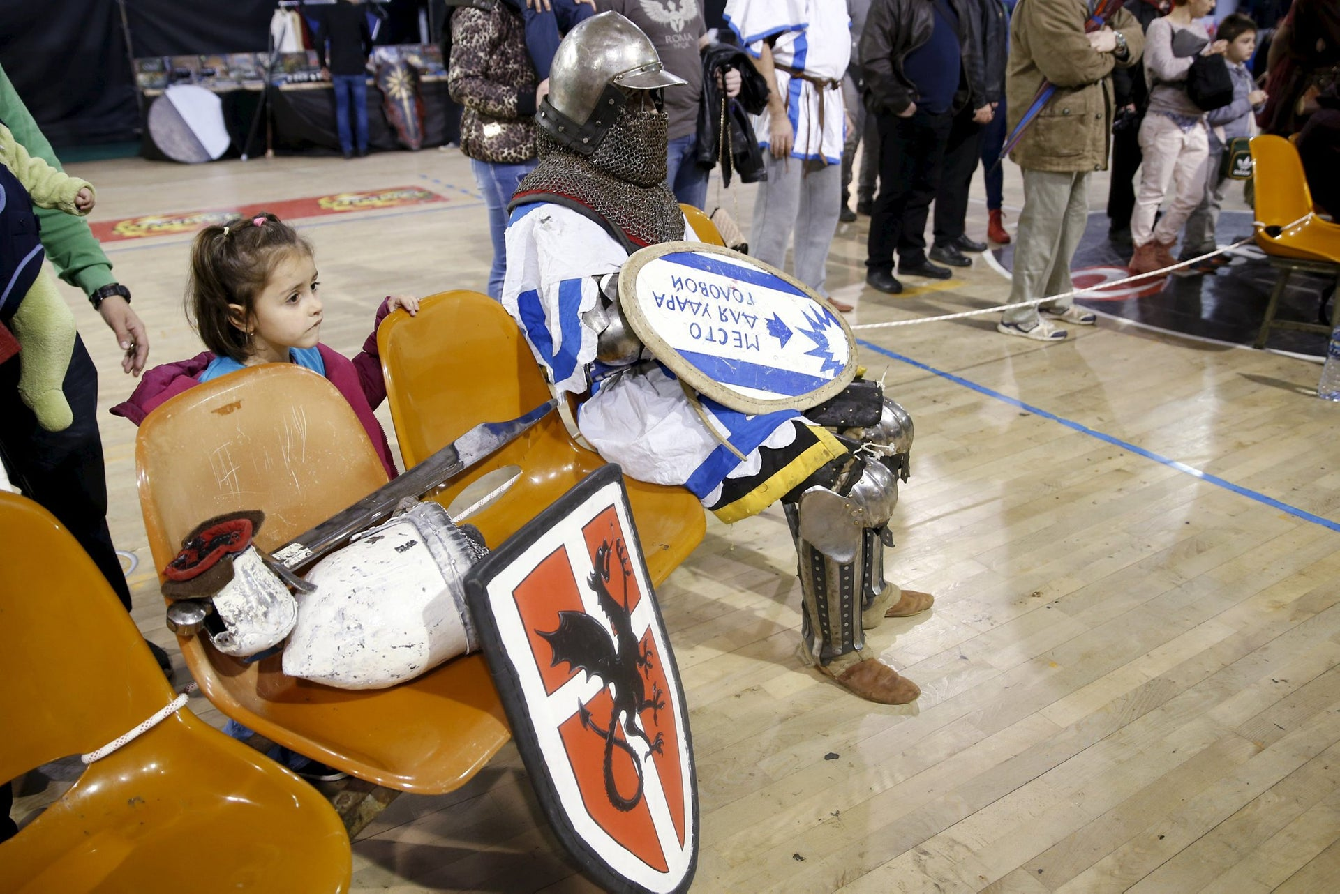 A man dressed as a knight waits before a fight at an international medieval tournament in Tel Aviv, January 23, 2016.