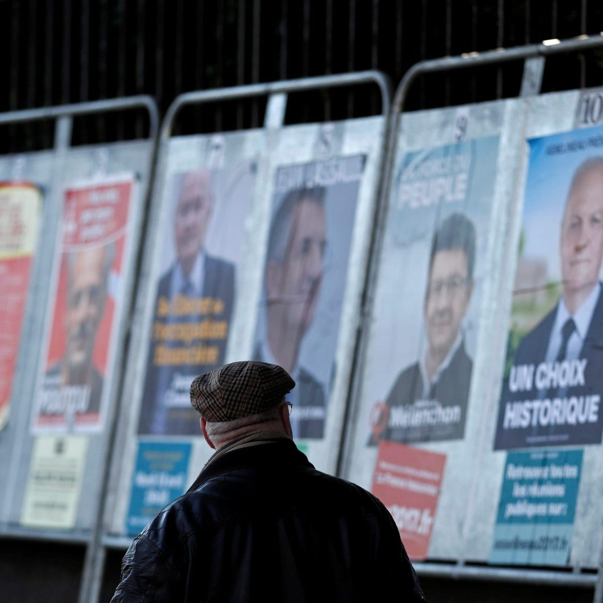 A man studying campaign posters of the 11 candidates running in the 2017 French presidential election, April 19, 2017.