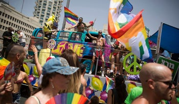 People participate the annual Gay Pride Parade in Tel Aviv, Israel, Friday, June 3, 2016.
