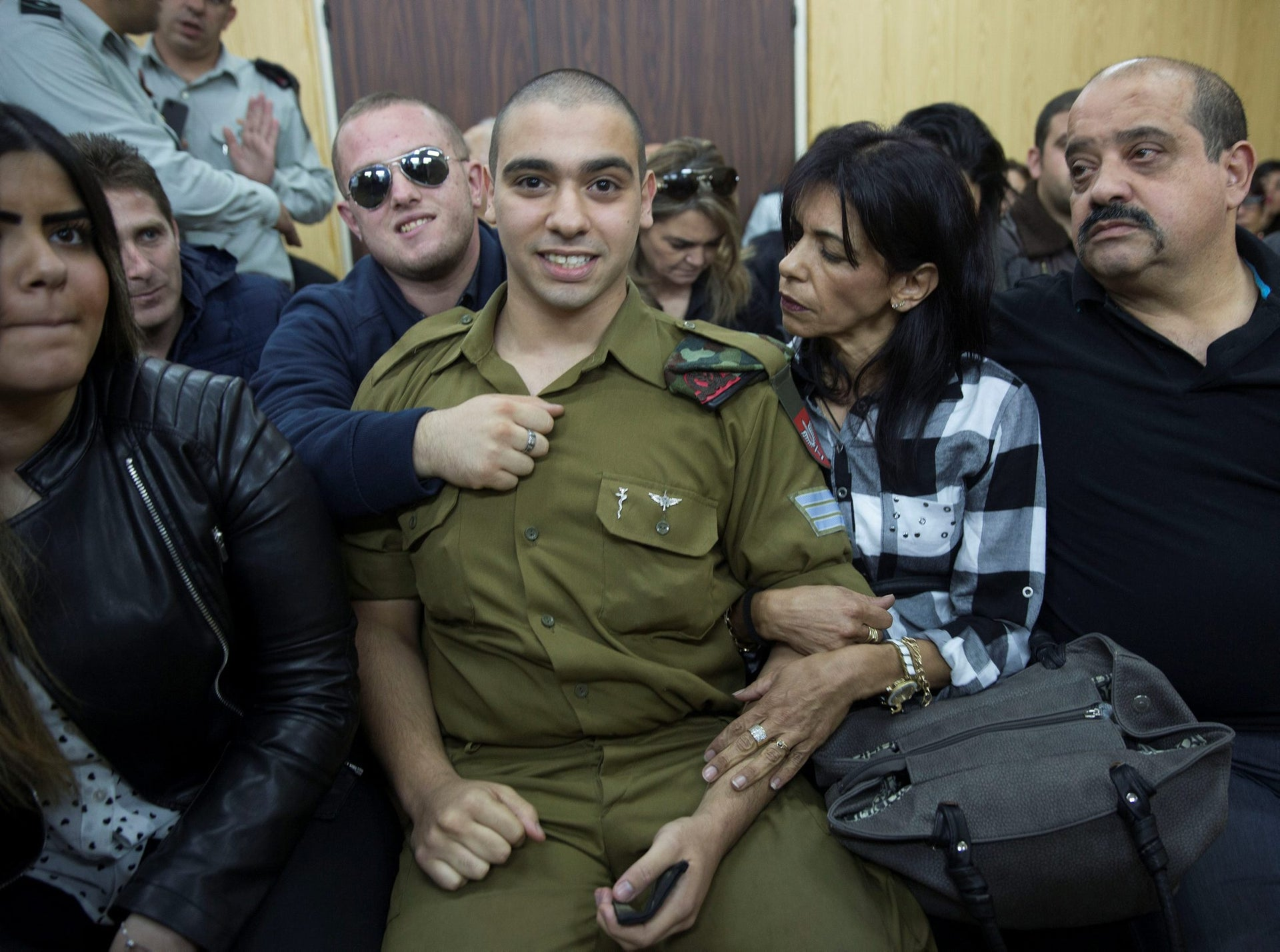 Israeli soldier Elor Azaria, who is charged with manslaughter by the Israeli military, sits to hear his verdict in a military court in Tel Aviv, Israel, January 4, 2017