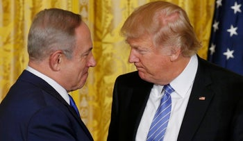 U.S. President Donald Trump (R) greets Israeli Prime Minister Benjamin Netanyahu at a joint news conference at the White House in Washington, U.S., February 15, 2017.