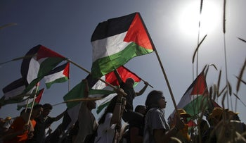 Israeli Arab demonstrators carrying Palestinian flags during a ceremony to mark what Arabs call the Nakba, or catastrophe, in the Israeli Arab village of Umm Al-Fahm, Wednesday, April 29, 2009.