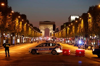 Police secure Champs Elysee after one policeman was killed and another wounded in a shooting incident in Paris, April 20, 2017.